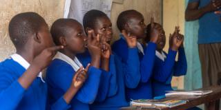 Pupils practise Kenyan Sign Language
