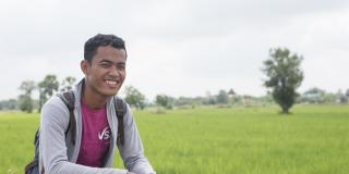 Cambodian volunteer Mongkol Lyn trains farmers to improve their understanding of modern farming technqies and the quality and inputs (chemicals etc) needed to ensure rice produced meets export criteria.