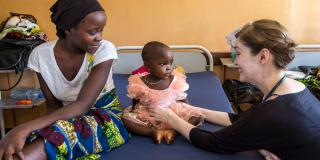 Volunteer paediatrician examines a two year old