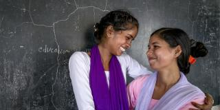 Volunteer and big sister Anu with Arti in Nepal.