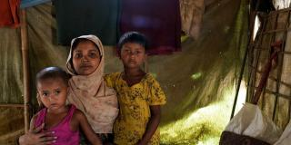 Sufia Begum (22) with her children inside their tent at Balukhali, Coxsbazar.