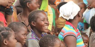 Smiling woman in crowd in Mozambique
