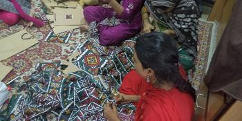 Women participating in a sewing workshop at Panah shelter