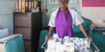 A nurse stands in the Chikurubi prison clinic with a trolley of medicines in front of her