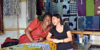 Volunteer Sandy Hung with Mayemba Mtema, a small shop owner in Tanzania