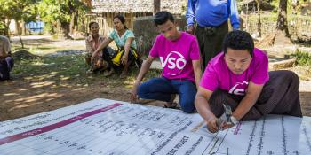volunteer prepares to set up the disaster risk management committee (DRMC) signboard at Kyatkathone Village,Kyike Ma Yaw Township, Mon state, Myanmar