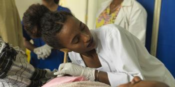 Doctor Tsigemariam Bekalu listens to a baby's heartbeat pre-delivery