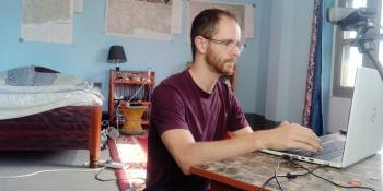 James Russell works at his laptop from his placement accommodation in Surkhet, Nepal.