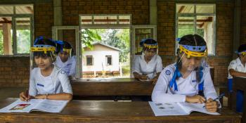 Girls study after going back to school in Myanmar.