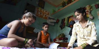 Little Sister Anjali Patel helping her nephews study at her home during the Covid 19 pandemic lockdown in Nepal