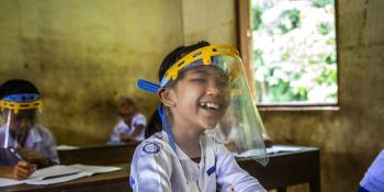 A schoolgirl in Myanmar back at school.