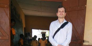 VSO volunteer Tom Legge outside a classroom in Ghana