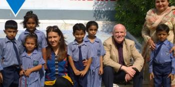 VSO Volunteer Bill Carr with children and colleague in Pakistan