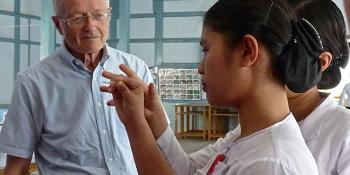 VSO health volunteer Phillip giving instruction in Myanmar