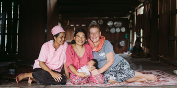 VSO volunteer Ans Ohms, midwife in Cambodia, with local colleague and mother
