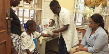 Andrew Sesay with Dr Padma and patients