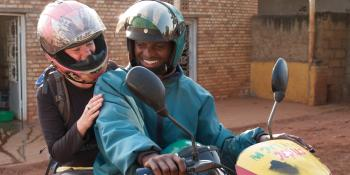CUSO-VSO volunteer Anna MacEachern is setting off for work on a motorbike. Anna is working as a Basic Methodology Trainer in Ngoma district, Rwanda.