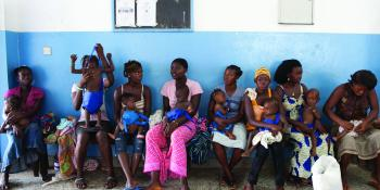 Mothers with their babies waiting at a clinic in Sierra Leone | VSO