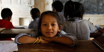 Girl in a classroom in Nepal | VSO
