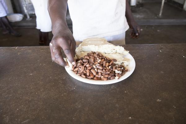 A prisoner's meal of beans and sadza (pounded maize meal) at Mutimurefu Prison.