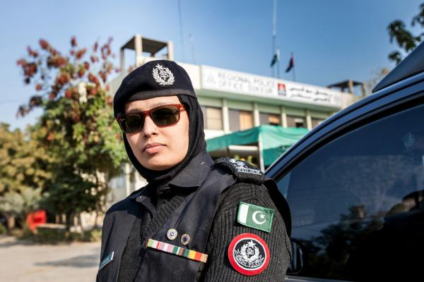 A female police officer stands in front of the regional police office