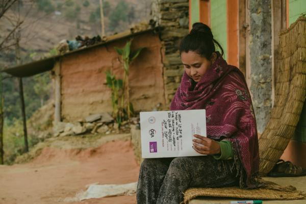 Laxmi Karki filling the record book as part of VSO research into gender based violence in Nepal