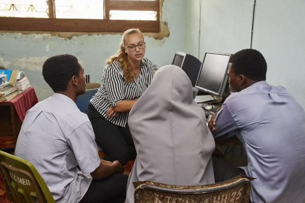 Tessa Huizinga, a corporate volunteer tutor with students Mohammed, Rukaiya and Wahid at the Training Services offices at Karume Institute of Science & Technology in Chukwani, Zanzibar