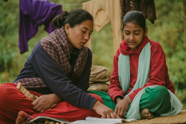 Big Sister Rama helps her Little Sister Pramila to study