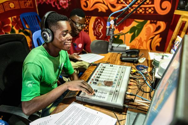 Two young male peer educators in the studio as they present a health programme on Radio Bangweulu