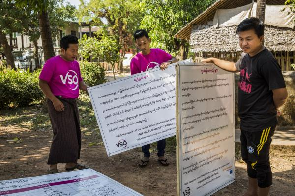 Volunteer in Myanmar. Community volunteers set up the disaster risk management committee signboard at Kyatkathone Village, Kyike Ma Yaw Township, Mon State.