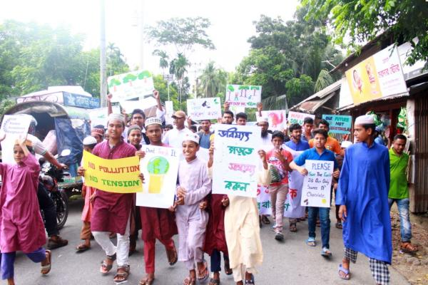 Young people hold placards as they march in the street in Bangladesh