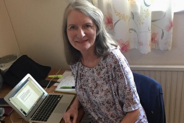 Gail Aldwin working at her laptop from her spare room.