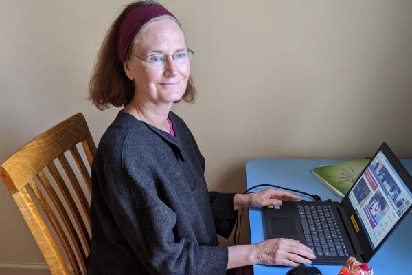 Anne Harrop working at her desk from her home in York.