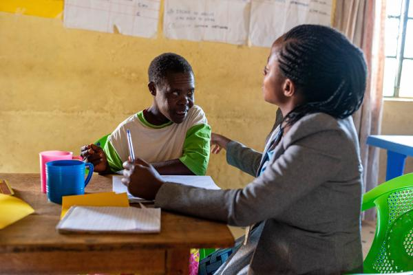 Clemenia* with her teacher Rael in a VSO-run catch up centre in Migori county, Kenya