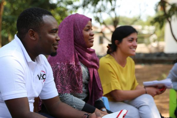 VSO national volunteers Ally Nguba and Asha Hamis sit with Randstad volunteer Veronica Conti as they carry out an aspirations analysis session