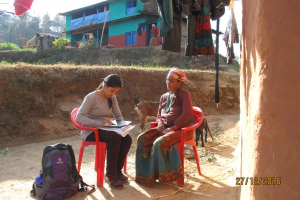 VSO volunteer sits with one married woman to conduct baseline research