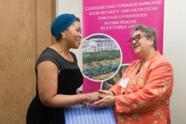 Baroness Barker presents an award from VSO to First Lady Tobeka Madiba Zuma