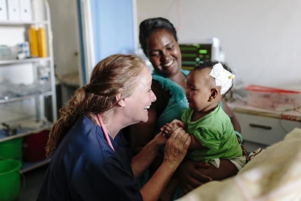 VSO volunteer Patricia Doyle with seven-month-old baby Eldana Akieiu and her mother Abaynesh Girma in the new paediatric High Dependency Unit (HDU) at Nigist Eleni Mohammed Memorial Hospital in Hosanna, Ethiopia