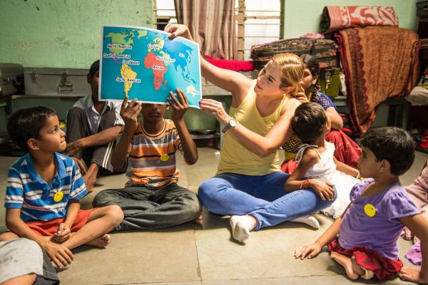 IBM corporate volunteer with children at a school in India