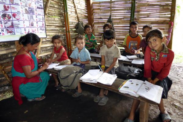 Children during a lesson in a Temporary Learning Centre supported by VSO in Lamjung district, Nepal.