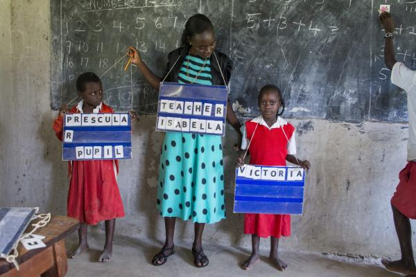 Teacher Isabella with her hearing impaired pupils in Kenya