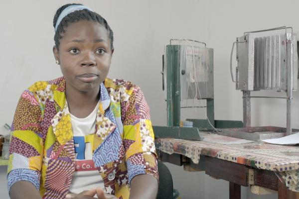 Rose Njau started her own candle business after support from VSO project TLED