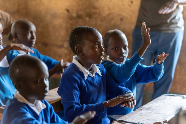 Students Learning Kenya sign language from VSO volunteers