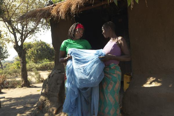 Community volunteer Luisa Jose visits Ana Noris to advocate malaria prevention by using Mosquito nets after cyclone Idai.