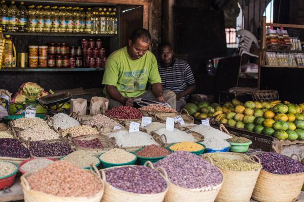 Zanzibar market counter with different sorts of beans and cereals