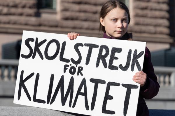 Climate activist Greta Thunberg holding a sign for the school climate strike.