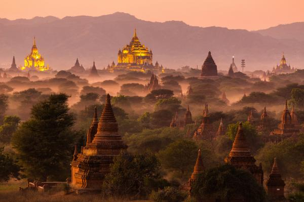 Pagoda landscape under a warm sunset in the plain of Bagan, Myanmar